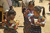 The local market with children eating snacks in the village of Santa Maria de Jesus in Guatemala.