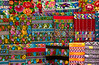 Closeup of colorful textiles hanging in a shop at the Comalapa market, Guatemala, Central America.