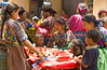 The local market with children and ladies shopping in the village of Santa Maria de Jesus in Guatemala, Central America.
