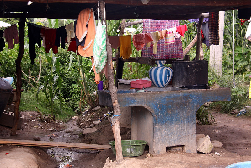 "The Lopez's pila - clothes for an extended family, dishes, and baby baths are done on this blue ""washing machine"".  There is an etiquette to simple handwashing.  If you are new to this try to observe someone ahead of you.  Do not contaminate the main water storage area with your dirty hands!"