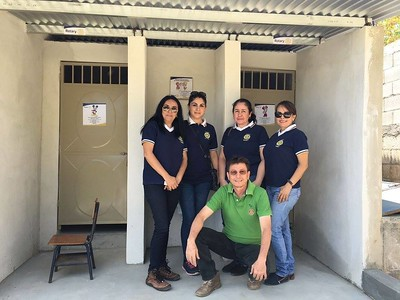 Rotarians by new bathrooms