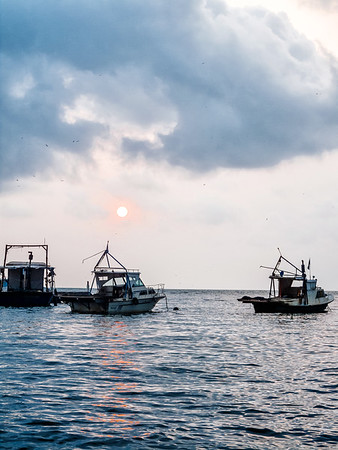 Fishing boats at sunrise in Livingston, Guatemala.