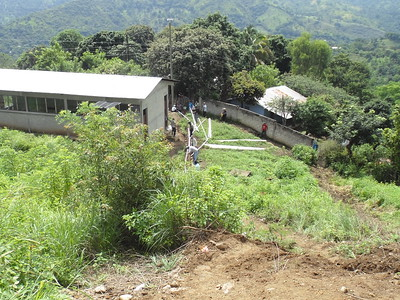"""Difficult work in the hilly terrain that this hamlet is located. Los Martínez is a """"Caserío"""" (hamlet) in the """"la aldea"""" (village) of Agua Zarca Arriba, in the Muncipal De San Jacinto, in the department of Chiquimula in Guatemala."""