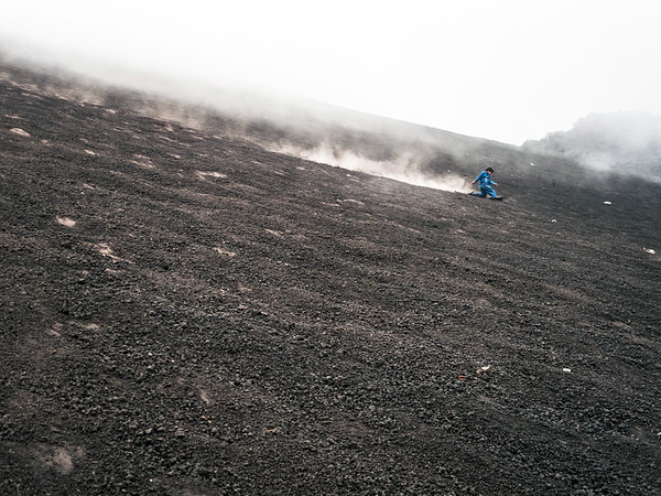 Kid playing on Pacaya Volcano's volcanic rocks and hill, Guatemala