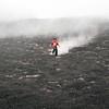 Kid playing on Pacaya Volcano's volcanic rocks and hill, Guatemala
