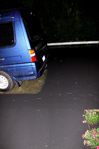 Our sidewalk is to the left of the flowers.  the white dots are ash falling and reflecting the flash of the camera.