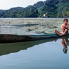 Boy in a boat on the Rio Dulce River in Guatemala