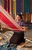 A Guatemalan lady weaveing at a hand loom in Santa Catarina Palopo, Guatemala.