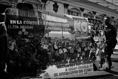 """Residents of the municipality of Cunén hold a banner displaying the results of a historic popular referendum held in October, 2009.  11,216 adults and 7,808 children, a total of 18,924 residents, voted """"No"""" against the installation of megaprojects in the municipality."""