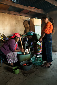 Women serve a ceremonial corn drink kown in Mam as Tzuchíl at the same school in the urban center.  The drink is prepared only on special occasions.