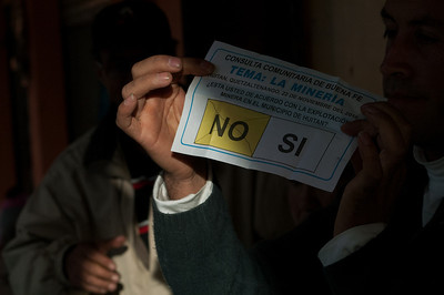 """Volunteers count the ballots following the close of voting.  The ballot reads: """"Do you agree with mining exploitation in the municipality of Huitán?"""""""