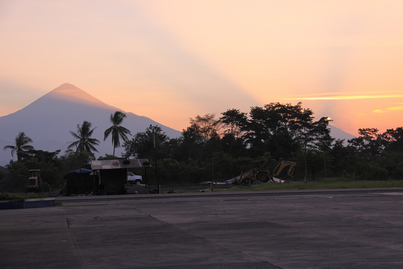 Early morning Sat.  The bright dot in the tree towards the right is a small puff from one of the active volcanoes in Guatemala.  From the Maranatha gas station.
