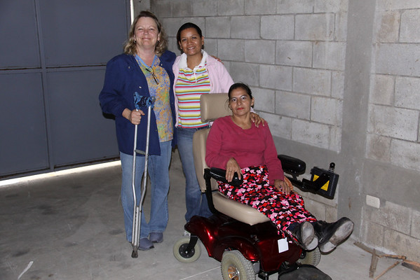 Cindy, Vivian and Patty and the motorized wheelchair from Samaritan's Purse.  YEA!