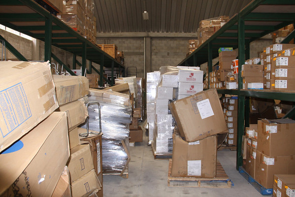 Packing it in there. We need a few days to clear some floor space for a fourth container filled with medicines.