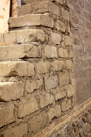 Adobe block wall... There is molasses in the mix, seriously.
