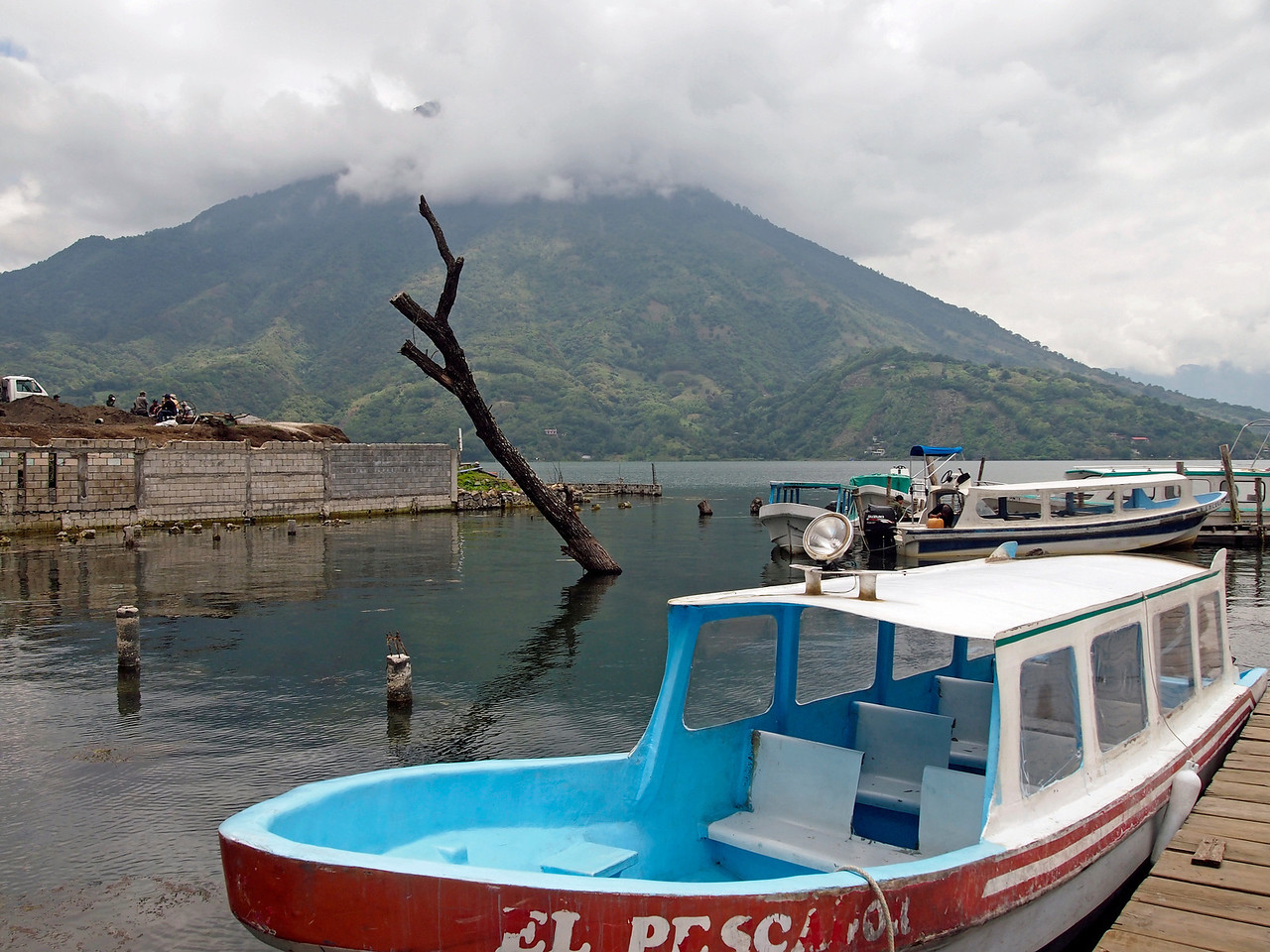 Boat at Santiago Atitlan - Lake level is rising drowning some trees