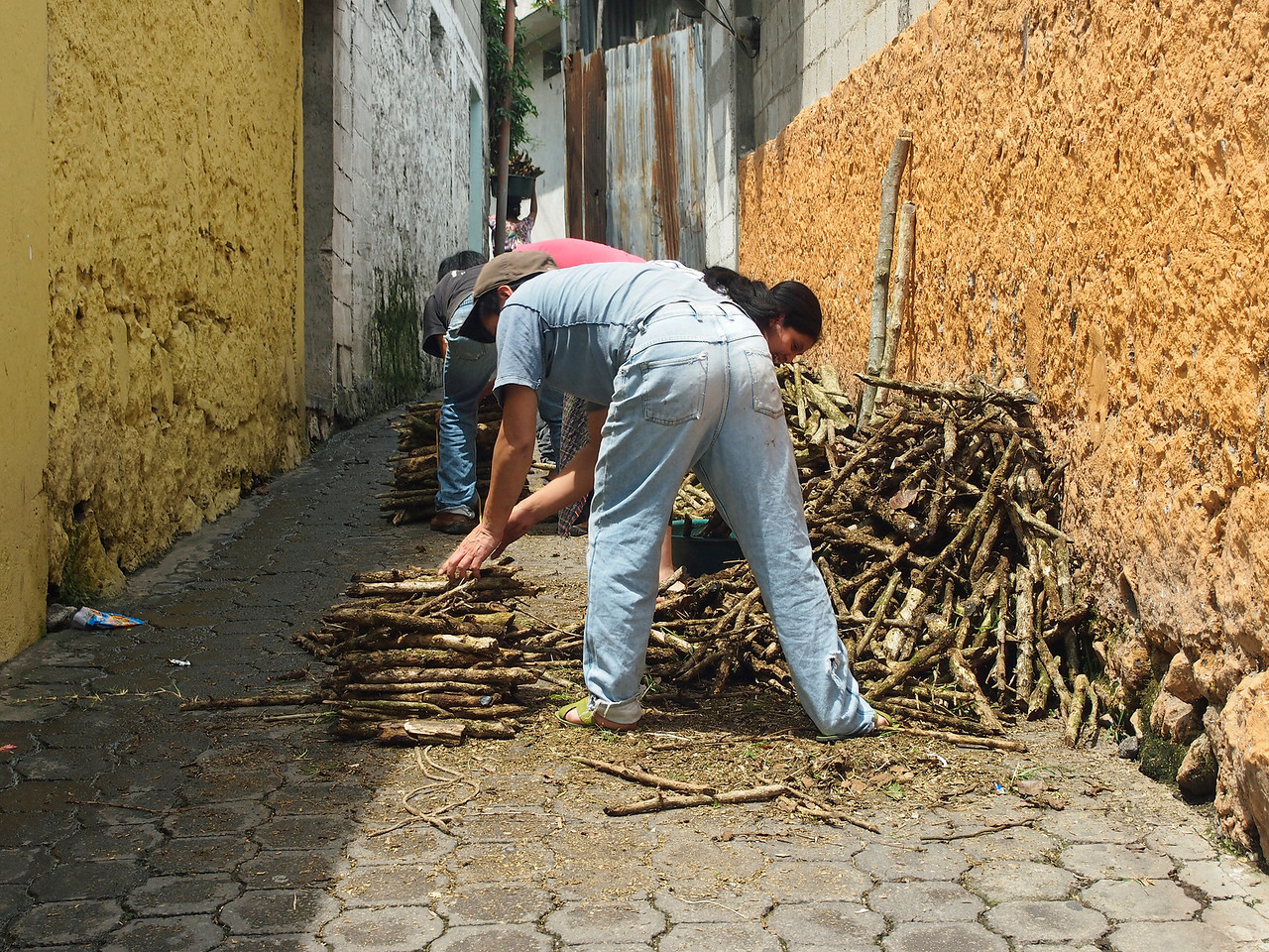 People sorting firewood for sale - Cooking and heating seem to be solely from wood or charcoal