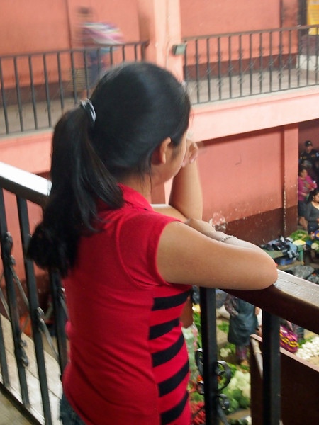 Girl overlooking the covered food section of the Chichicastenango market
