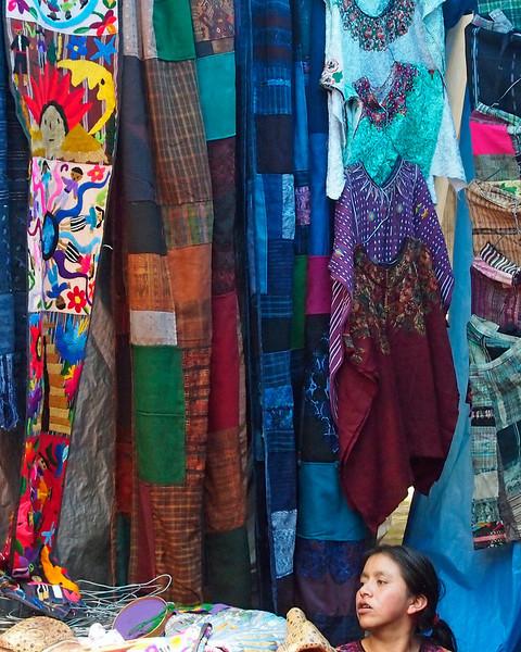 Vendor in market stall