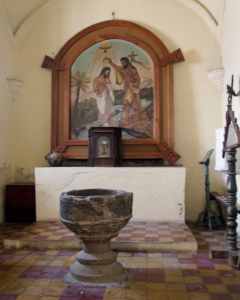 Church baptistry with painting of Christ being baptized by John the Baptist