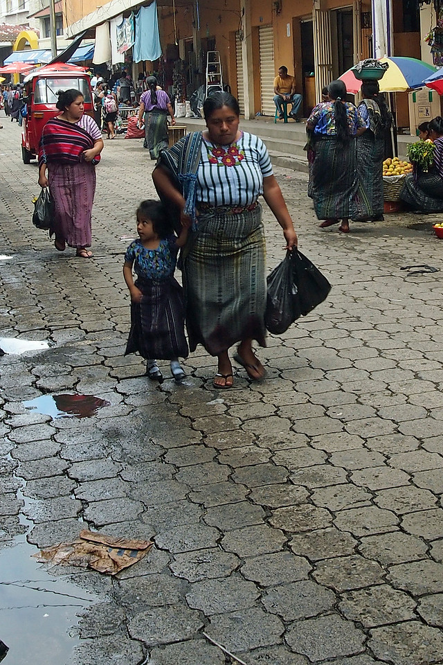 Market street - women and little girl in traditional dress