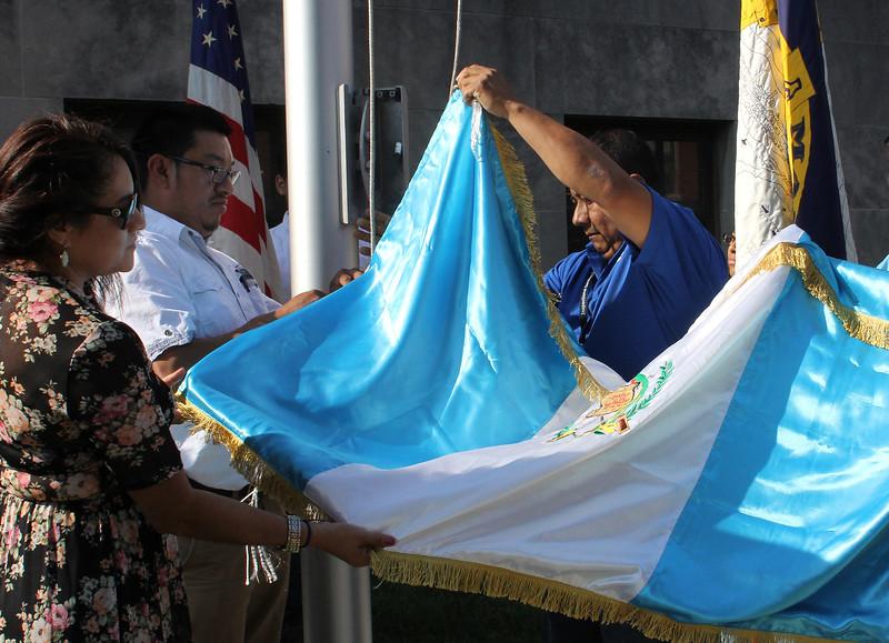 Lynn, Ma. 9-13-17. Lilian Zuniga, Israel Deac and Eric Barrios rasing the Guatemalan Flag at Lynn City Hall.