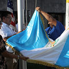 Lynn, Ma. 9-13-17. Lilian Zuniga, Israel Deac and Eric Barrios rasing the Guatemalan Flag at Lynn City Hall.