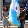 Lynn, Ma. 9-13-17. Lilian Romero and Joselyne Reynoso head for the flag pole outside of Lynn City Hall for the Guatemalan flag raising.