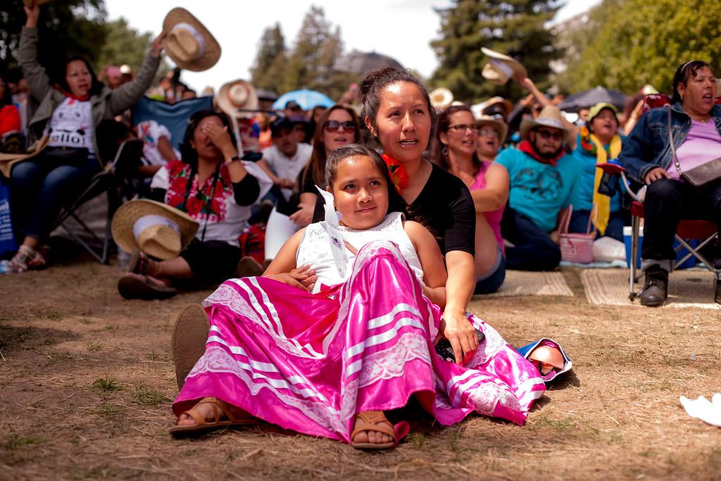 . Susana Garcia embraces her daughter, Viviana Diaz, a Santa Cruz Gardens second-grader, at Viva Oaxaca Guelaguetza in Santa Cruz\'s San Lorenzo Park on Sunday, May 20, 2018. (Kara Meyberg Guzman -- Santa Cruz Sentinel)