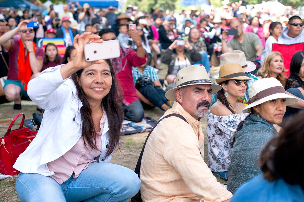 . Audience members film the dancers of Senderos at the Guelaguetza celebration on Sunday, May 20, 2018 in San Lorenzo Park. (Kara Meyberg Guzman -- Santa Cruz Sentinel)