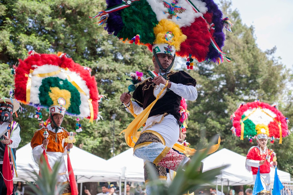 . A young man wears a penacho headdress while performing a traditional Oaxacan dance at the Guelaguetza celebration in San Lorenzo Park in Santa Cruz on May 20, 2018. (Kara Meyberg Guzman -- Santa Cruz Sentinel)