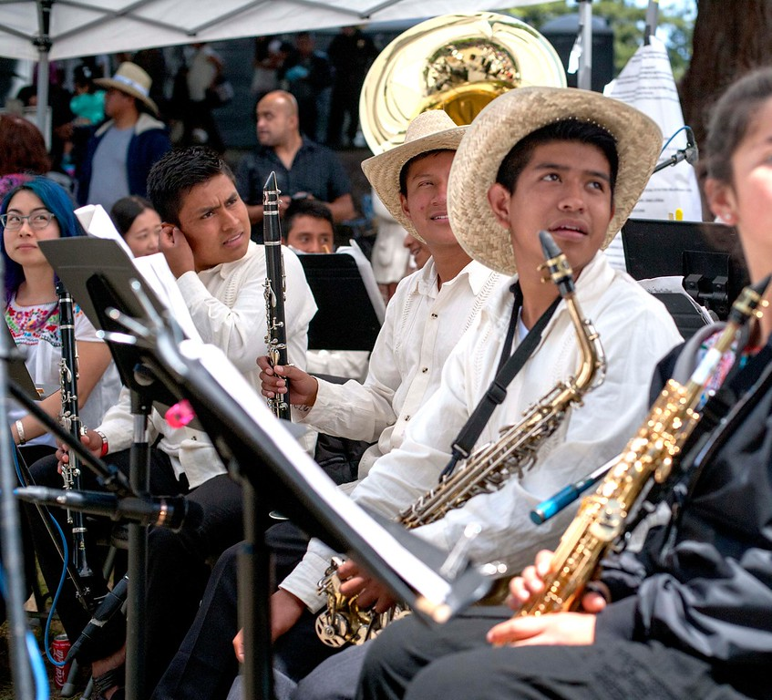 . Members of CIS #8 band from Oaxaca, Mexico watch the performers on Sunday, May 20, 2018 in San Lorenzo Park. (Kara Meyberg Guzman -- Santa Cruz Sentinel)