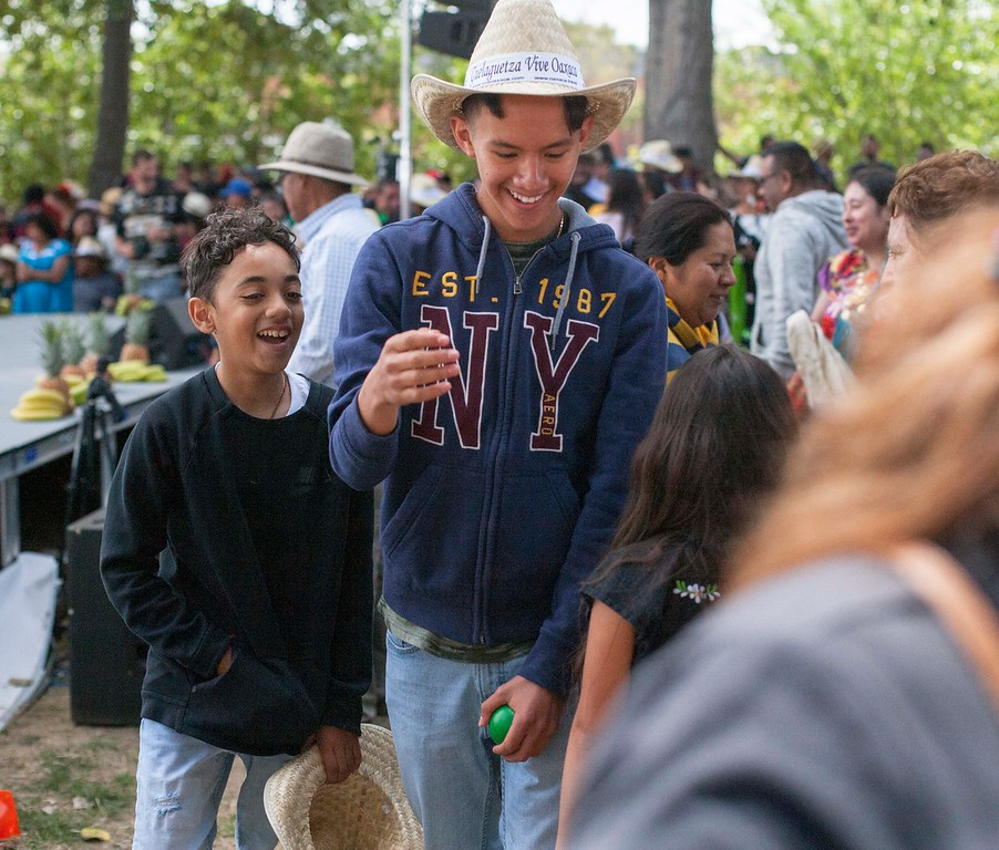 . Boys smile after trying to grab some of the freebies tossed from the stage at the Guelaguetza celebration on Sunday, May 20, 2018 in Santa Cruz. (Kara Meyberg Guzman -- Santa Cruz Sentinel)