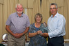 Andrew Courtney receives the 2015 Floral Guernsey Conservation & Wildlife Award from Jean Griffen on behalf of the parish of St. Saviour
