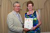 Deputy David Inglis presents Sarah Plumley of Floral Forest Group with a Gold award