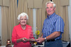 Maud Falla presents the D.H. and O.N. Falla trophy to John Garnham of St Martin parish