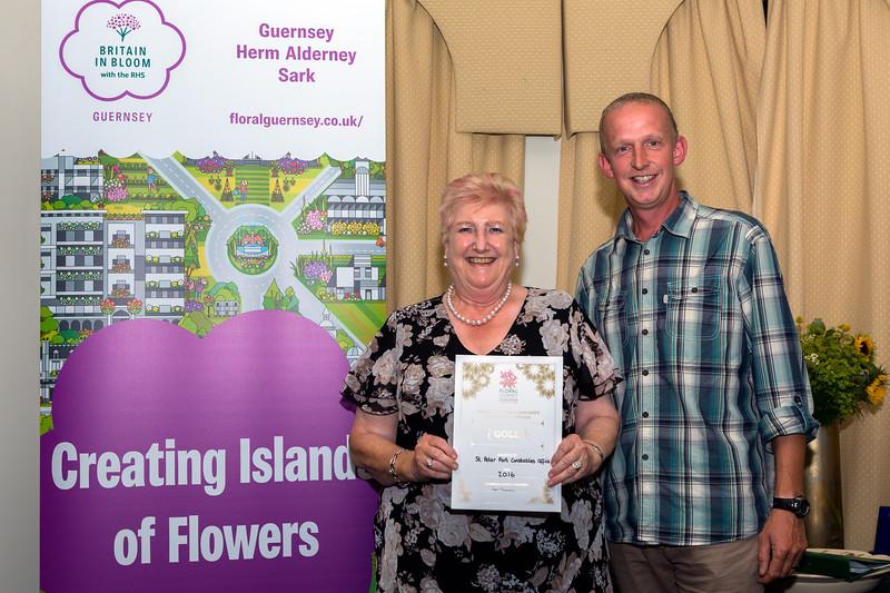 St Peter Port Constable Jenny Tasker receives a Gold Award for the St Peter Port Constables Office floral display