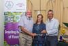 Jan Dockerill presents Floral Guernsey's Conservation & Wildlife Award to St Saviour