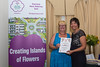 Sue Williams (left) collects Special Commendation award on behalf of Charles Maitland at 2016 Floral Guernsey Awards
