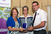 Jane St Pier of the Guernsey Youth Commission presents the Young People's Award to Ann Wragg and Steve Byrne