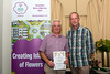 John Garnham with a Gold Award for the St Martin's Douzaine rooms floral display