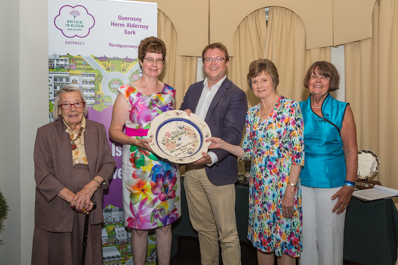 Forest Parish receives the winner's plate for the Best Floral Display from Martyn Dorey, President of the Guernsey Chamber of Commerce