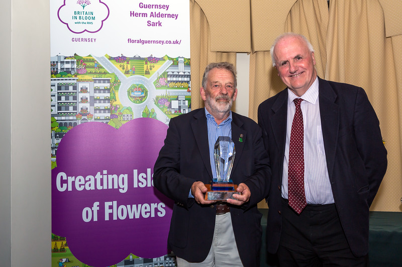 Larry Trigwell receives the Tourism Award on behalf of Forest parish from Deputy Peter Ferbrache