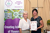 Sue  Wood presents Janine King with a Special Commendation at the 2016 Floral Guernsey Awards