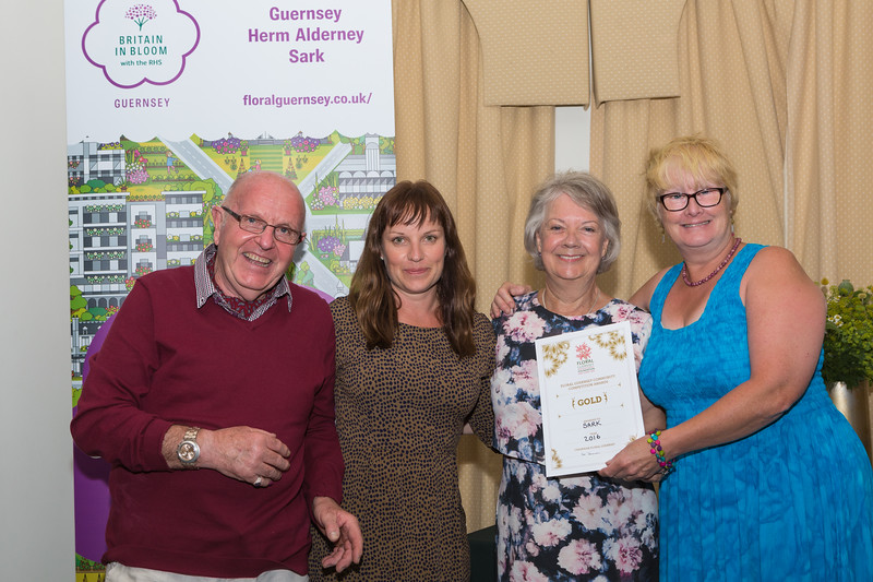Dame Mary Perkins presents Sark with Floral Guernsey Gold Award