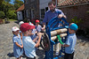 Christian Morris shows primary school pupils how to use a laundry wringer