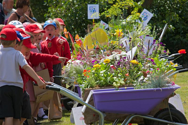 Vauvert Primary School pupils inspecting schools Floral Guernsey wheelbarrow competition