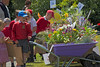 Vauvert Primary School children inspect floral displays in wheelbarrows