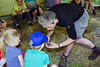 Bush craft expert David Hunt shows primary school children how to create a fire