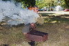 Bush craft expert David Hunt controls a fire during 'A Magical Day in the Park'